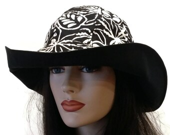 Reversible Wide Brim Sun Hat in black and white batik print with adjust fit plus chinstrap for boating/convertibles/windy days