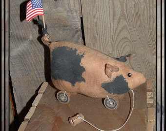 Primitive Folk Art pull toy pig black spots spool wheels HAFAIR OFG spotted cloth pig American flag