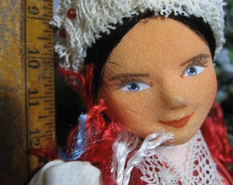 Folk Art Doll Perhaps Hungarian Ten Inches High Bright Colors Lace Trim Beads Ribbon Apron Red Boots As Is