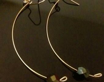 Elegant crescent with w iridescent black bead