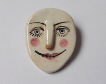 Funny face brooch