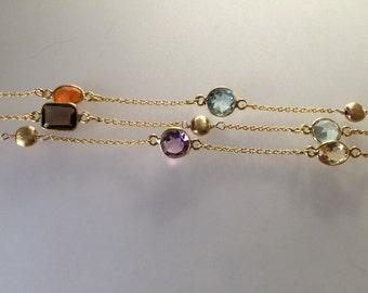 Bezel Gemstone and Gold Bracelet