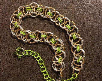 Chain Maille Bracelet , gold and silver twist rings with green rings