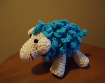 Curlycue lamb in turquoise and cream