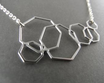 geometric jewelry, geometric necklace, heptagon necklace, silver necklace