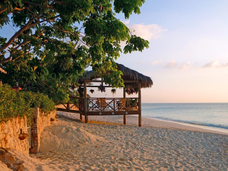 Sunset cayman island photograph beautiful beach home for Build your own beach house