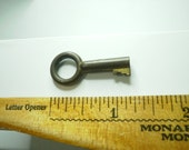 Skeleton Key or Clock Key - 1-5/16  inch  - Open Bow- Brass - does not stick to magnet.