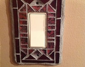 Mosaic rocker switch plate cover. Deep shades of cranberry and Van Gogh glass.