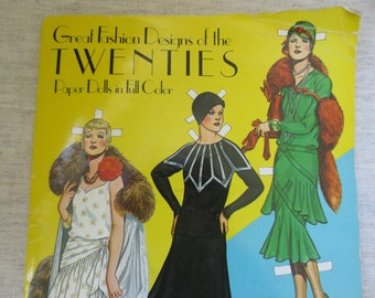 Beautiful vintage soft cover fashion designs of the twenties paper dolls book in full color. Lot of 1 book.