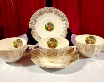 Cups (3) and Saucers (2) 22 Karat GOLD warranted Nasco Southern Belle Courting Scene