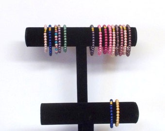 Beaded Stretchy Bracelets, Be The Statement - Good for Everyday ... Lots of color, Stackable,  Faux Pearls  ... Only 2 dollars each ...