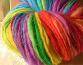 Handspun rainbow sparkling self striping extreme thick and thin art yarn wool blend 200 yds hand dyed