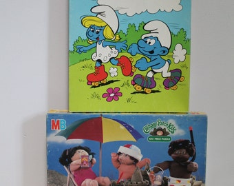 Milton Bradley Smurfs 24 Piece Puzzle and 1984 Cabbage Patch Kids 100 Piece Puzzle, Complete