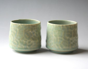 Pair of celadon tea tumblers with dimpled surface texture