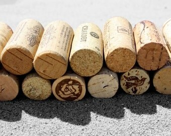 Corks in the sand: Color Photograph