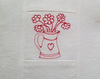 Plain and simple cushion with red flower heart jug in white vintage linen with ladybird buttons.