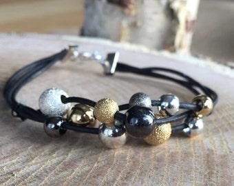Mixed metal black leather bracelet