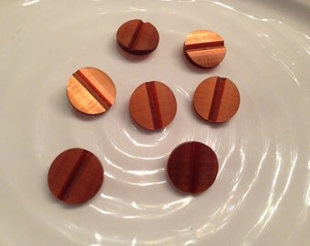 All the same button - 7 vintage brown plastic shank buttons