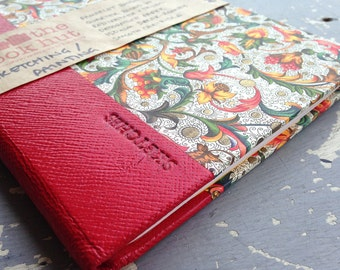 Pamphlet Binding - Quarter bound in red leather and carta fiorentina decorative paper