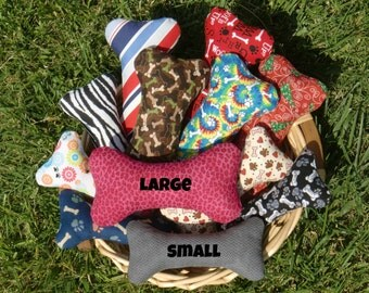 squeaky bone-shaped dog toys, two sizes, many designs to choose, two Kong squeakers each, durable cotton fabric, polyester stuffing. #DB050