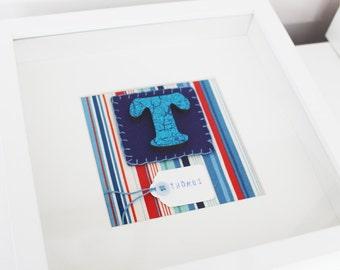 Blue framed initial
