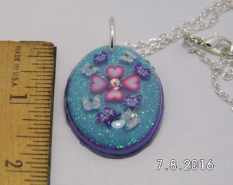 Oval Pendant With Hearts and Butterflies