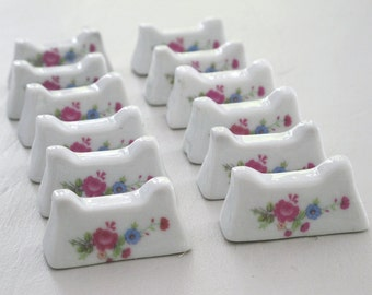 Set of 12 French porcelain knife rest , white porcelain and flowers roses transferware, Cutlery rests