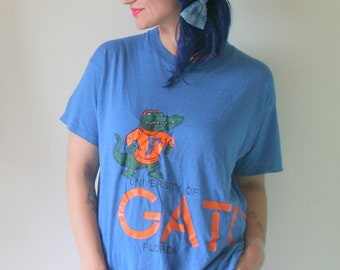1970s FLORIDA GATORS Tshirt..size medium to large adults....football. NFL. retro tee. rad. 70s. blue. orange. jerzees shirt. hipster tee.