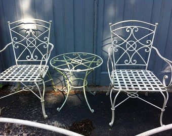 Wrought Iron Scrolled Chairs and table