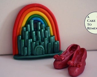 Rainbow cake topper with Emerald City and Ruby Slippers for birthday cakes.