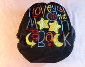 """SassyCloth one size pocket diaper with """"I love you to the moon and back"""" embroidery on black PUL. Made to order."""