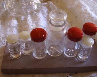 Seven (7) Vintage Glass Storage Bottles