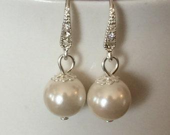 Pearl dangle earrings on crystal ear wires. Wedding jewelry