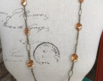Coral orange long necklace. Antique brass chain