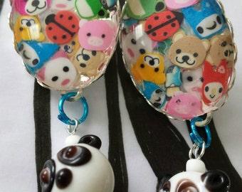 Sale was 18 now 16uk Silvertone Oval Cabochon Cute Cartoon Animal earrings with Glass Panda dangles.