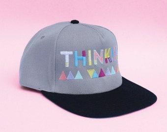 Thinking Cap (Grey). Flat peak cap.