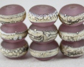 9 Translucent purple beads with silver-ivory trail, matte finish (Item 160140)