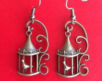 I know why the caged bird sings earrings
