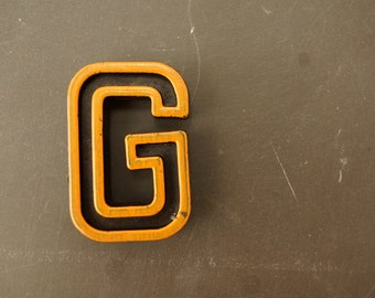"Vintage Industrial Letter ""G"" Black with Light Orange and Blue Paint, 2"" tall (c.1940s) - Monogram Display, Shadow Box Letter, Art Supply"