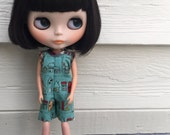 Rosiee Gelutie Short Style PlaySuit TO HELP CHRISTIN repair her home after a tree fell through the roof