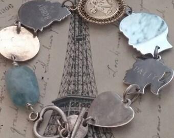 SILHOUETTE CHARMS VINTAGE antique sterling assemblage bracelet