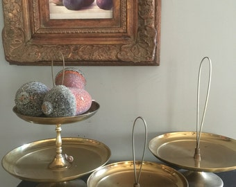 Collection of brass serving trays. Mid century appetizer dishes.
