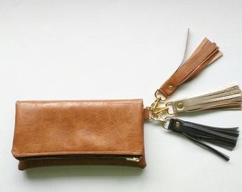 Cognac brown faux leather clutch with floral interior