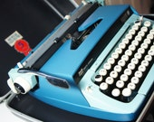 Beautiful Vintage blue SCM Smith Corona Galaxie Twelve XII 12 Portable Mechanical Typewriter with original case. Made in U.S.A.