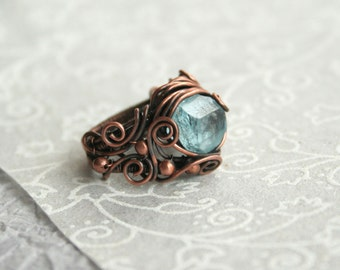 Iceblue - uncut blue topaz copper ring size 7 intricate wire wrapped OOAK