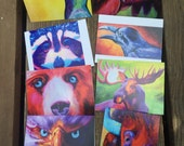 Note cards based on my original oil paintings.  Set of 8 with envelopes in a linen pouch with an art card attached.  Spirit animals, totems
