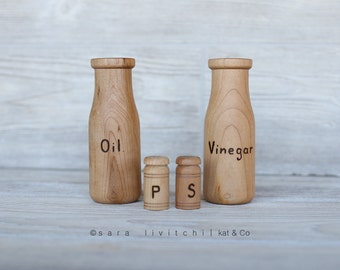 Oil and Vinegar, salt and pepper.   Wooden bottles for play kitchen.