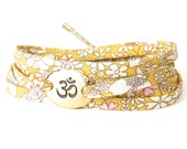 Sunflower yellow yoga bracelet, meaningful gift for Yoga teacher, bracelet with Ohm charm and Liberty fabric with a classic floral print,