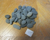 50 Oval and Oblong Smooth Beach Stones in Shades of Dark Gray