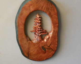 Hand carved evergreen tree in northern California redwood.